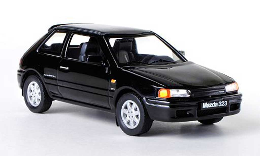Mazda 323 1/43 IXO GTX noire LHD 1989 miniature