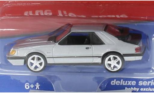 Ford Mustang 1/64 Auto World SVO grise 1984 miniature