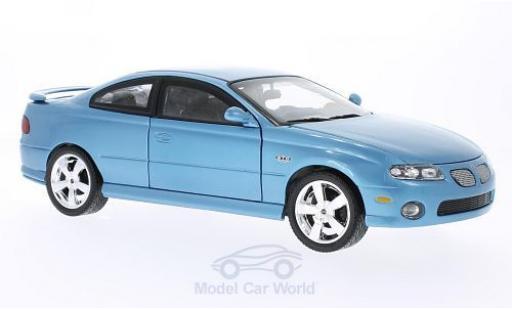 Pontiac GTO 1/18 ERTL American Muscle metallic-hellbleue 2004 miniature