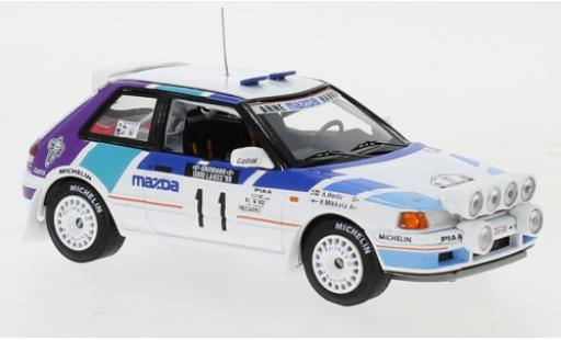 Mazda 323 1/43 IXO GTX No.11 Rally Team Europe 1000 Lakes Rallye 1990 with night lights H.Mikkola/A.Hertz miniature