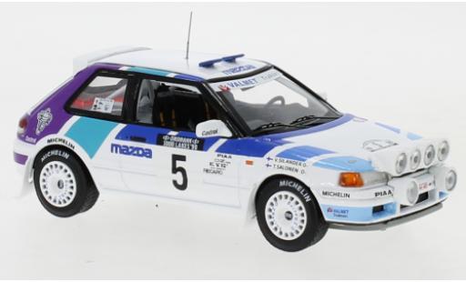 Mazda 323 1/43 IXO GTX No.5 Rally Team Europe 1000 Lakes Rallye 1990 with night lights T.Salonen/V.Silander miniature
