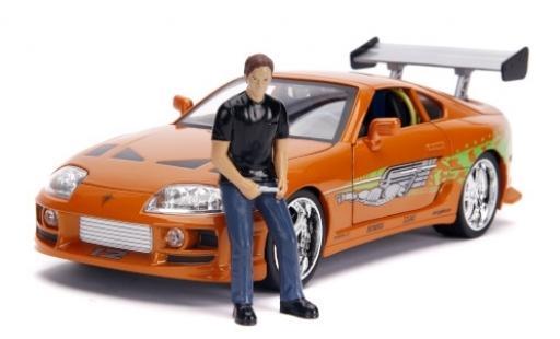 Toyota Supra 1/18 Jada metallise orange/Dekor Fast & Furious 1995 avec figurine et Scheinwerferfunktion modellino in miniatura