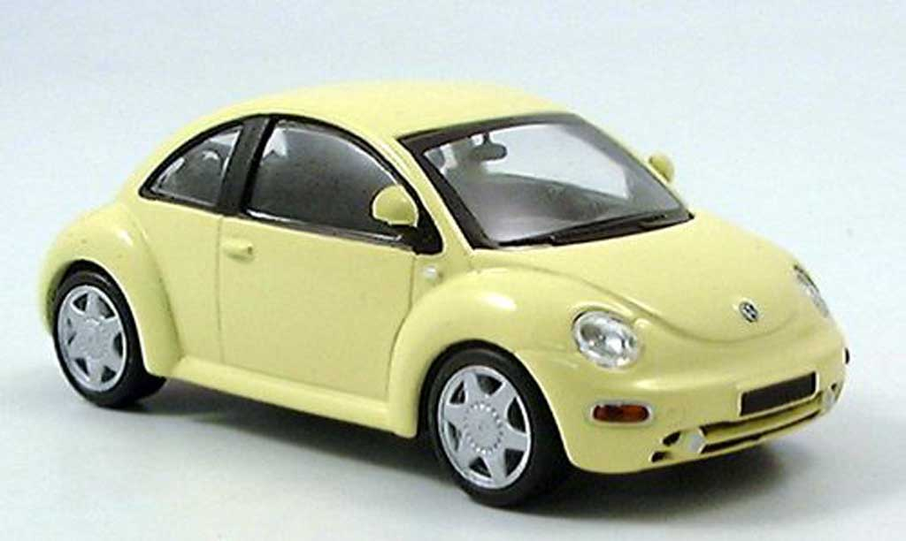 volkswagen new beetle miniature jaune del prado 1 43 voiture. Black Bedroom Furniture Sets. Home Design Ideas