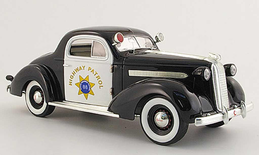 Pontiac De Luxe 1/18 Signature Highway Patrol noire/blanche 1936 miniature