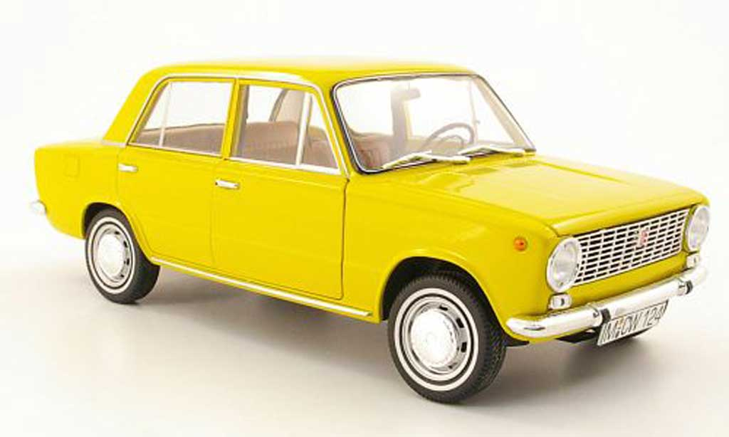 Fiat 124 1/18 IST Models yellow l.e. 1012 1971