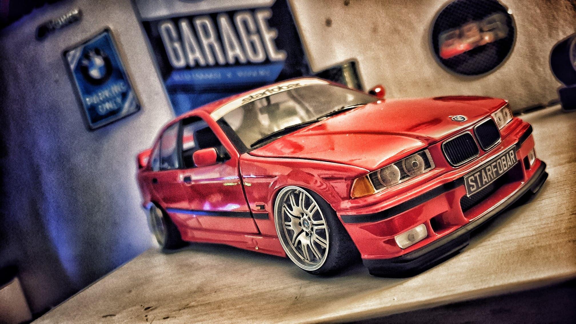 Bmw 318 E36 1/18 Ut Models red sedan with big offset wheels tuning diecast