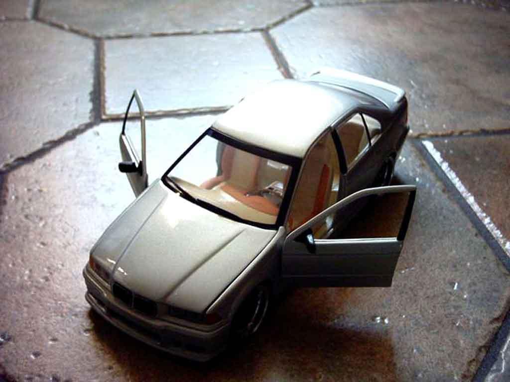 Bmw 318 E36 1/18 Ut Models is berline jantes racing harts 18 pouces