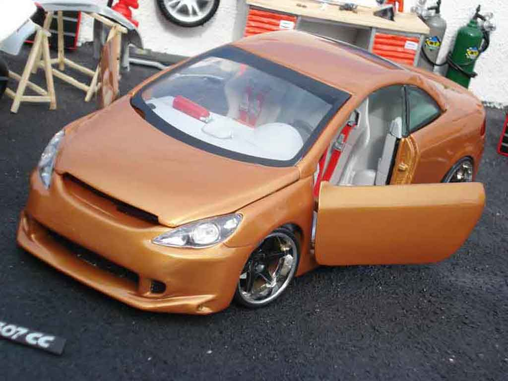 Peugeot 307 CC 1/18 Solido orange tuning miniature