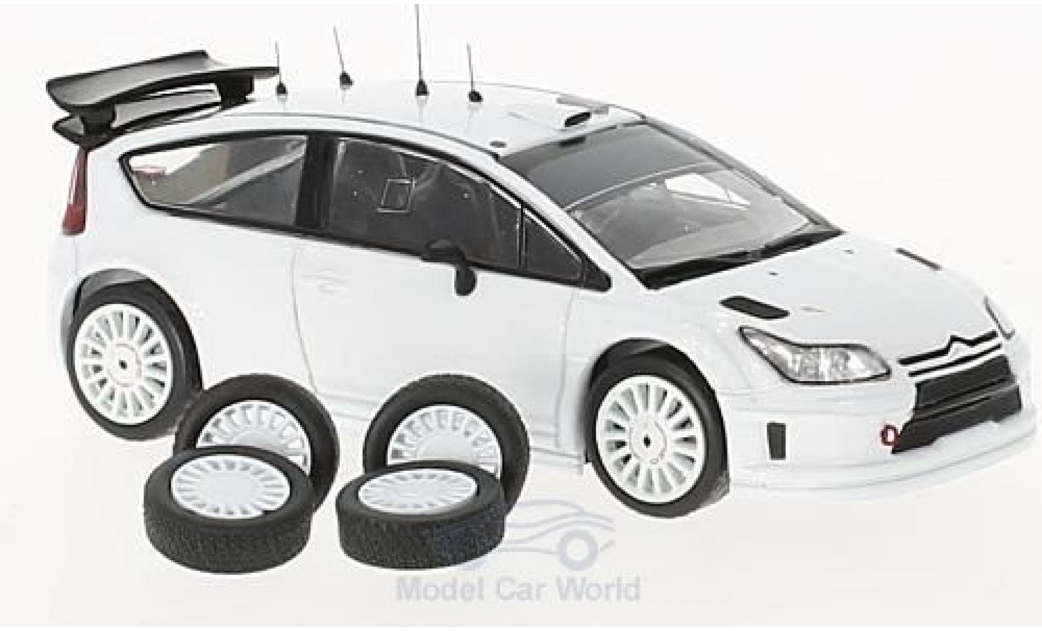 Citroen C4 WRC 1/43 IXO WRC blanche 2010 Plain Body Version inklusive 4 Ersatzräder