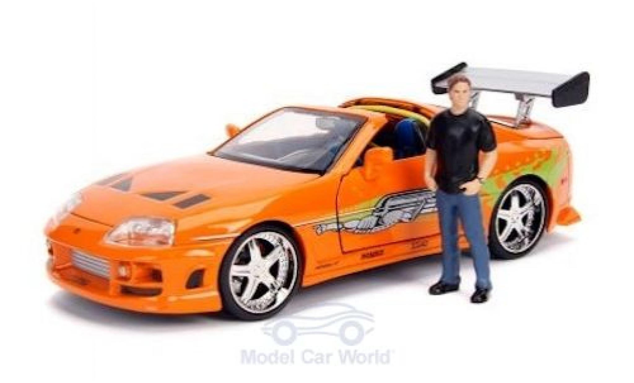 Toyota Supra 1/24 Jada Toys Toys Toys Toys orange/Dekor Fast & Furious 1995 mit Figur
