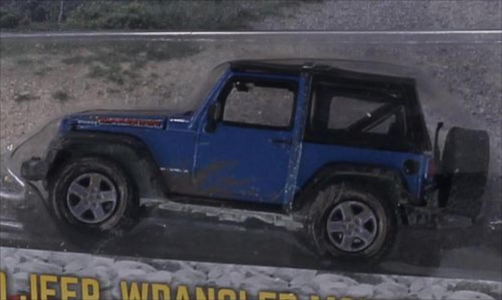 Jeep Wrangler 1/64 Greenlight bleu/matt-noire 2010 miniature