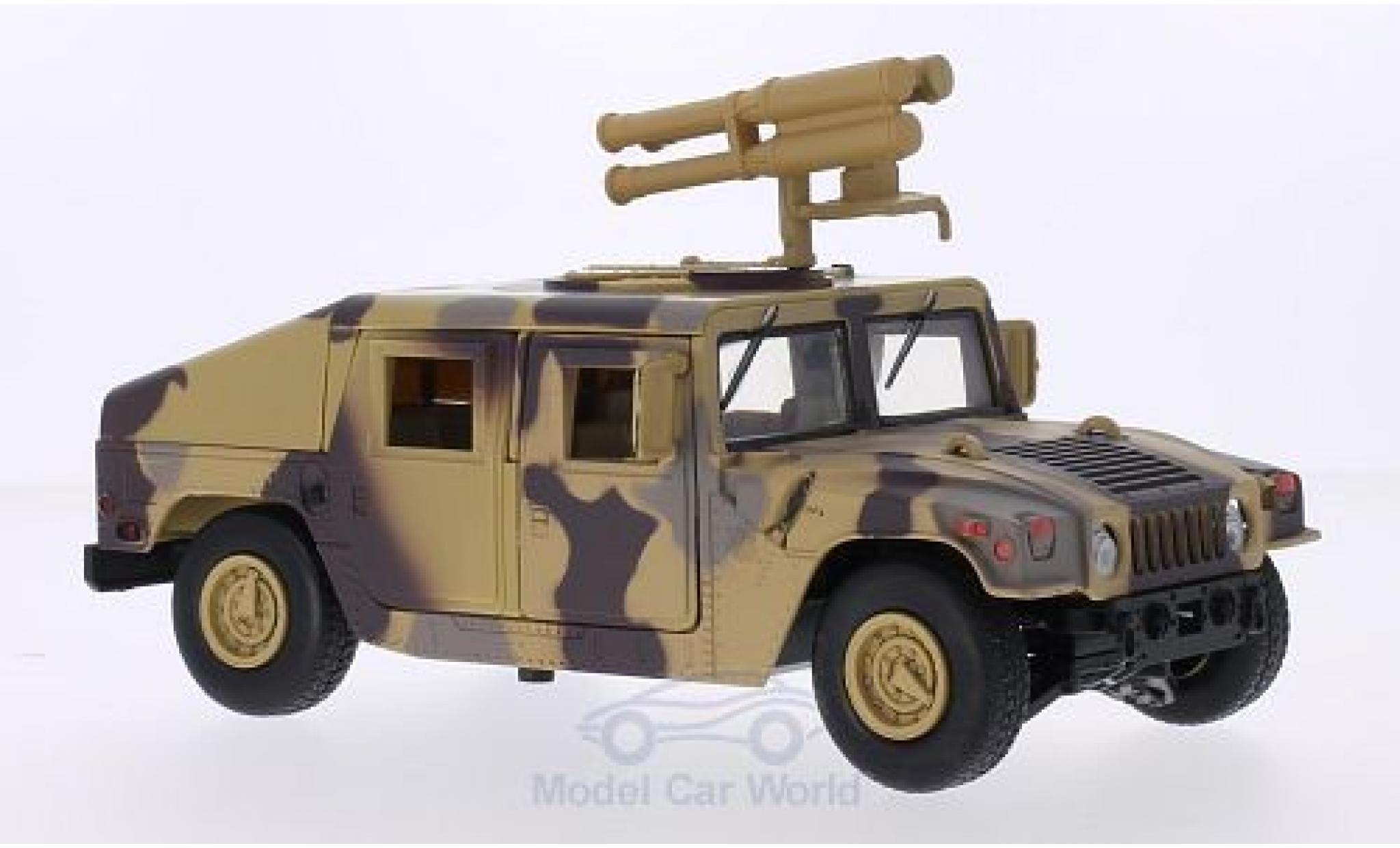 Hummer Humvee 1/24 Motormax mit Starburst Raketenwerfer camouflage