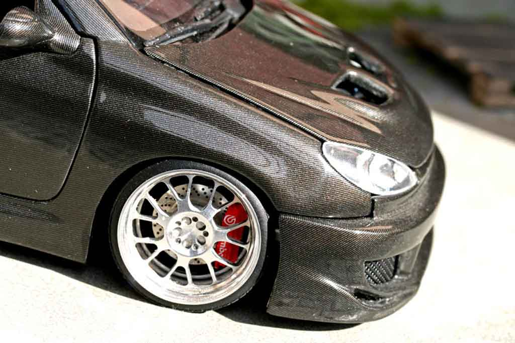 Peugeot 206 CC carbon covered tuning Solido. Peugeot 206 CC carbon covered miniature auto miniature 1/18