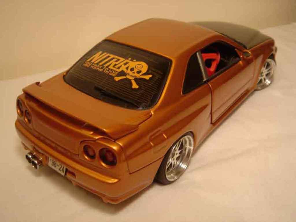 nissan skyline r34 miniature orange carbon kit nos autoart 1 18 voiture. Black Bedroom Furniture Sets. Home Design Ideas