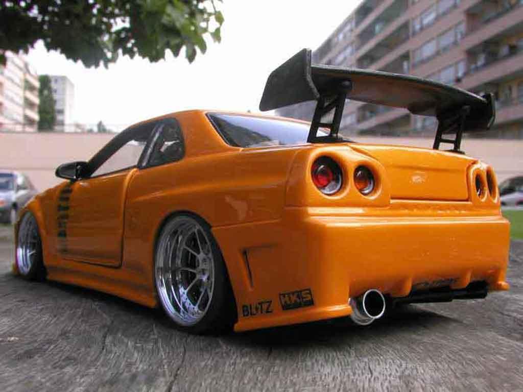 Modèle réduit Nissan Skyline R34 gt aileron et capot carbone r tuning Autoart. Nissan Skyline R34 gt aileron et capot carbone r miniature 1/18