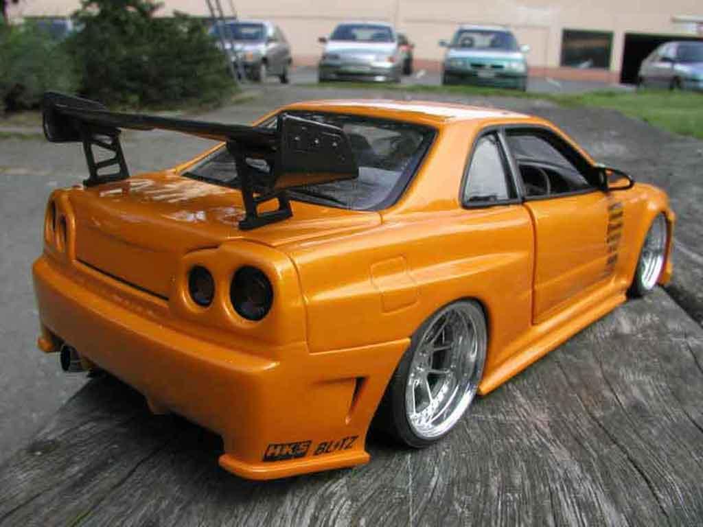 Auto miniature Nissan Skyline R34 gt aileron et capot carbone r tuning Autoart. Nissan Skyline R34 gt aileron et capot carbone r miniature 1/18