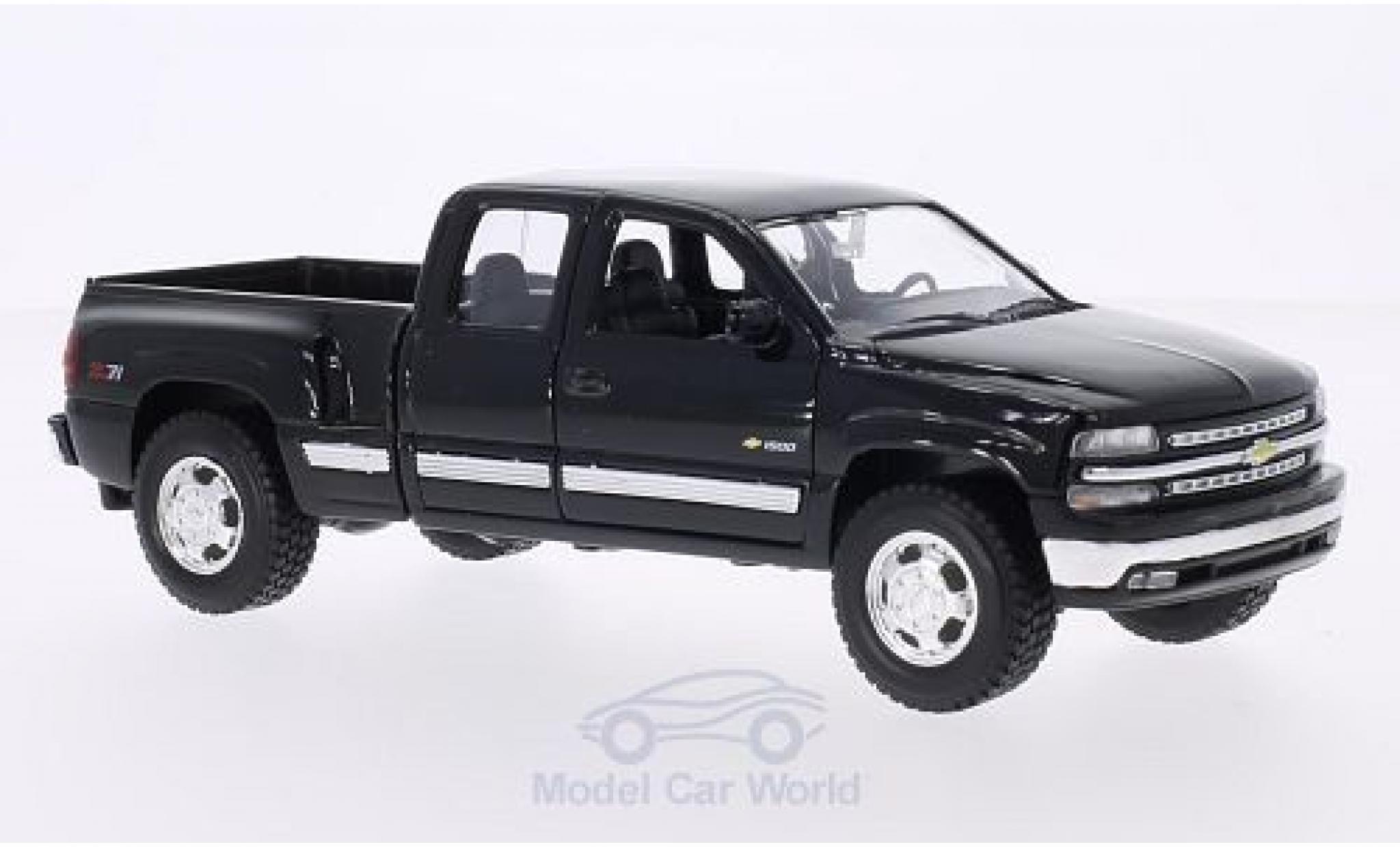 Chevrolet Silverado 1/24 Welly noire 1999