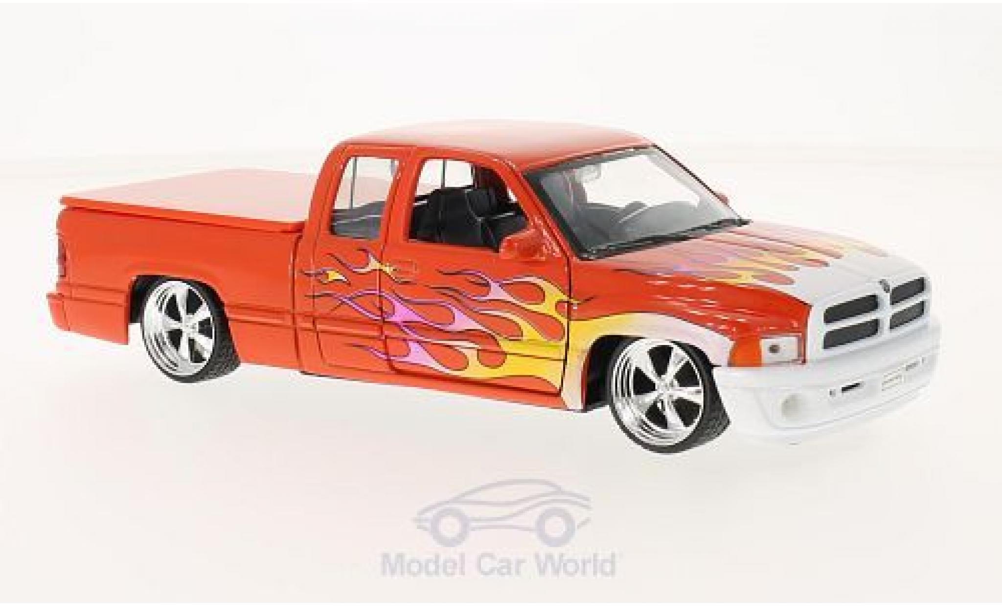 Dodge RAM 1/24 Welly Ram Quad Cab 1500 Sport dunkelorange/Dekor