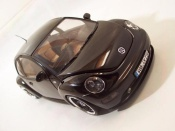 Miniature Volkswagen New Beetle   men in black