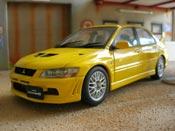 Mitsubishi Lancer Evolution VII giallo