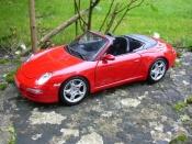 Porsche 997 Cabriolet  S rouge Maisto 1/18