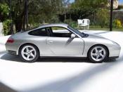 Porsche 996 Carrera   4S grise Maisto