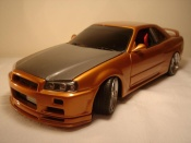 Nissan Skyline R34  orange carbon kit nos Autoart 1/18