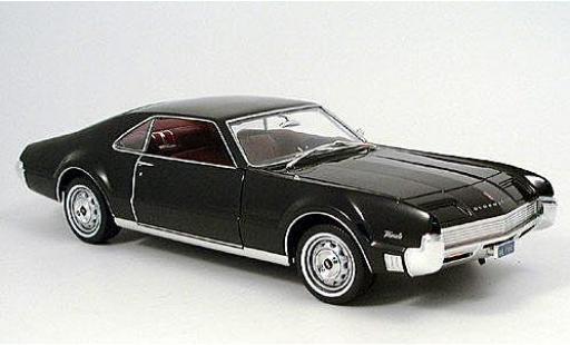 Oldsmobile Toronado 1/18 American Mint/Motormax noire 1966 miniature