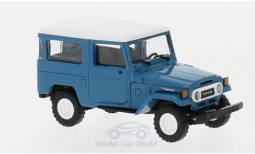 Toyota Land Cruiser 1/87 Busch J4 bleue/blanche miniature