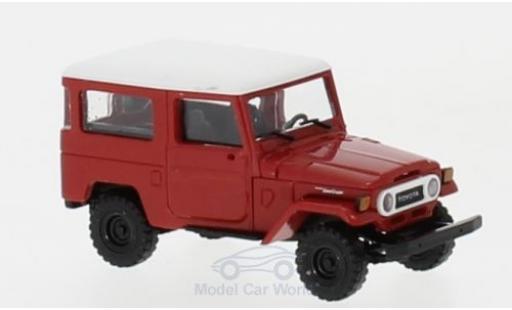 Toyota Land Cruiser 1/87 Busch J4 rouge/blanche miniature