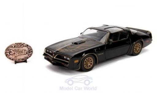 Pontiac Firebird 1/24 Jada Toys Toys Toys Toys noire/Dekor Smokey and the Bandit 1977 mit Gürtelschnallen-Replik miniature