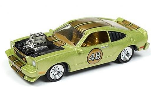 Ford Mustang 1/64 Johnny Lightning II Cobra metallise verde/gold The Spoilers 1976 tuning sans Vitrine coche miniatura