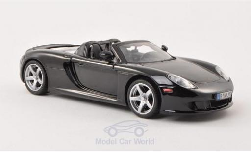 Porsche Carrera GT 1/24 Motormax noire ohne Vitrine miniature