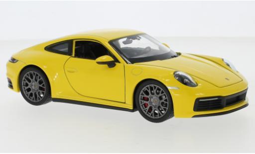 Porsche 911 1/24 Welly Carrera 4S jaune miniature
